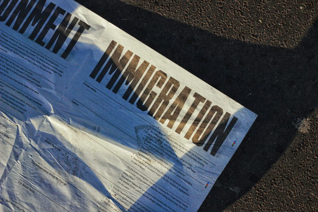 Newspaper with a immigration headline